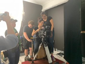 crew filming on a camera dolly